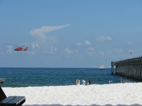 A helicopter hovers low over Pensacola Beach